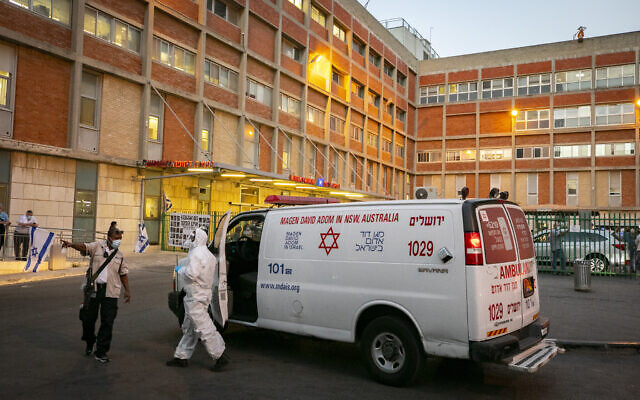 Magen David Adom workers wear protective clothing outside the coronavirus unit at Hadassah Ein Karem hospital in Jerusalem, on October 19, 2020. (Olivier Fitoussi/Flash90)