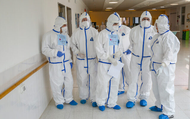 Ziv hospital team members wearing safety gear as they work on a coronavirus ward on February 04, 2021. (David Cohen/Flash90)