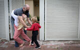 Grandparents meets with their grandchildren in their home in Ramat Gan, on February 05, 2021. ( Chen Leopold/Flash90)