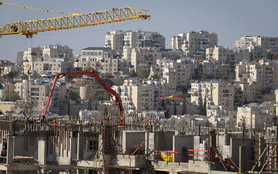 Construction work for new housing in the West Bank settlement of Modi'in Illit, January 11, 2021. (Flash90)