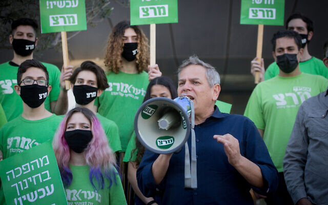 Meretz chief Nitzan Horowitz and supporters of his left-wing party protest against the government's decision to keep schools closed, outside the Education Ministry in Tel Aviv, February 9, 2021. (Miriam Alster/Flash90)