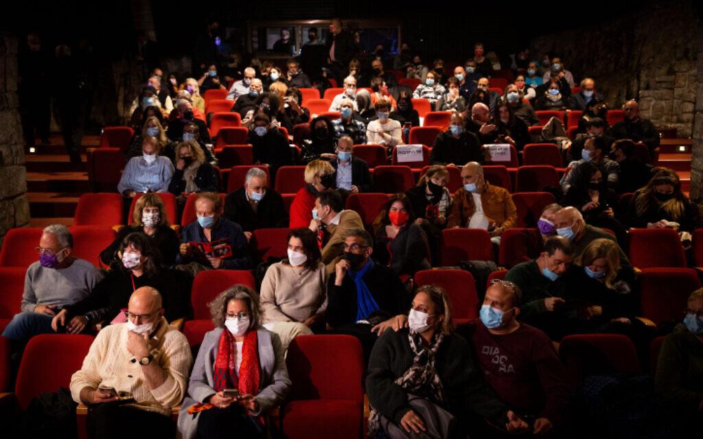 Theater-goers at the Khan theatre in Jerusalem on February 23, 2021.  (Yonatan Sindel/Flash90)