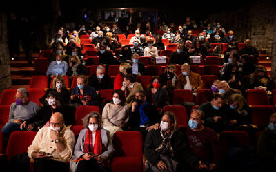 Theater-goers at the Khan theatre in Jerusalem on February 23, 2021.  (Yonatan Sindel/Flash90)