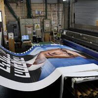 Campaign posters being printed of New Hope party leader Gideon Sa'ar ahead of the Israeli elections, on February 25, 2021. (Yossi Zeliger/Flash90)