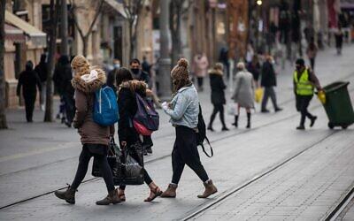 People walk on Jaffa street in downtown Jerusalem on March 1, 2021. (Yonatan Sindel/Flash90)