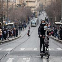 People walk on Jaffa Street, in downtown Jerusalem on March 1, 2021. (Yonatan Sindel/Flash90)