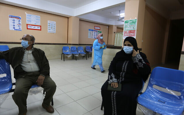 A medical worker of UNRWA gives a shot of the Sputnik V COVID-19 vaccine at UNRWA's clinic in the Rafah, in the southern Gaza, on March 3, 2021. (Abed Rahim Khatib/Flash90)