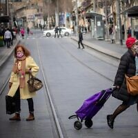 People walk on Jaffa Street in downtown Jerusalem on March 3, 2021. (Yonatan Sindel/Flash90)