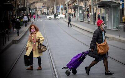 People walk on Jaffa Street in downtown Jerusalem on March 3, 2021. (Yonatan Sindel/Flash90)