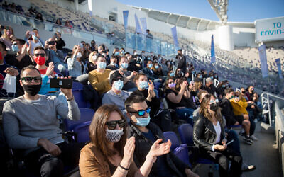 Israelis enjoy a concert organized by the Tel Aviv municipality at Bloomfield Stadium on March 5, 2021. (Miriam Alster/FLASH90)