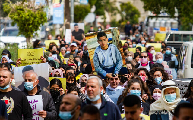 Israeli Arabs and activists protest against the murder of teenager Mohammed Adas, in Jaljulia, March 12, 2021. (Flash90)