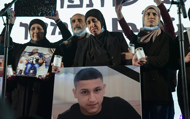 Protestor holds image of Muhammad Abdelrazek Ades at a Tel Aviv protest against surging crime and violence in Arab communities, March 13, 2021 (Flash90)