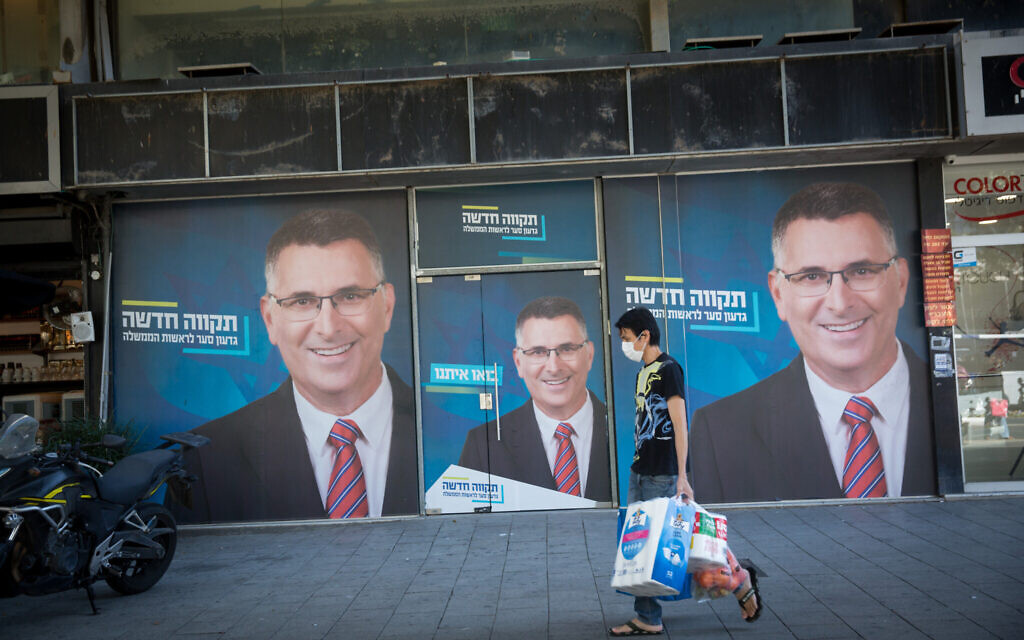 Campaign posters prior to the upcoming Israeli general elections, in Tel Aviv, on March 18, 2021 (Miriam Alster/FLASH90)