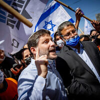 Religious Zionism party leader Bezalel Smotrich, left, and Itamar Ben Gvir of the far-right Otzma Yehudit party at an election campaign tour at the Mahane Yehuda market in Jerusalem on March 19, 2021, four days before the general election. (Yonatan Sindel/Flash90)