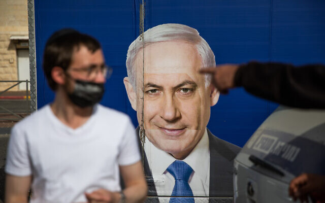 A campaign poster of Likud's Prime Minister Benjamin Netanyahu in Jerusalem, March 21, 2021. (Shir Torem/Flash90)