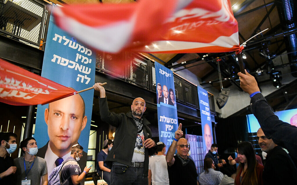 Yamina supporters at a party event in Petah Tikva on March 23, 2021. (Avi Dishi/Flash90)