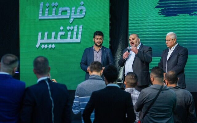 Ra'am party leader Mansour Abbas, center, at a post-election event in Tamra on March 23, 2021. (Flash90)