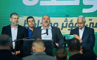 MK Waleed Taha (L) and Ra'am leader Mansour Abbas and party members at the Ra'am headquarters in Tamra, March 23, 2021, at the end of voting on election day. (Flash90)
