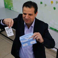 Joint List party leader Ayman Odeh casts his ballot at a voting station in Haifa during the Knesset elections, March 23, 2021. (Jamal Awad/Flash90)