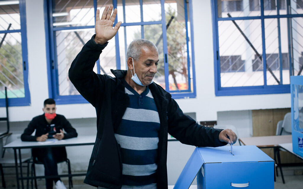 An Israeli cast his vote in the general election, in Kafr Manda, northern Israel, on March 23, 2021. (Jamal Awad/FLASH90)