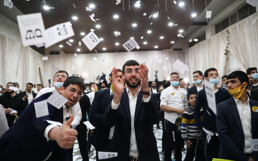 Shas supporters react to the results of the exit polls in Jerusalem on March 23, 2021. (Noam Revkin Fenton/Flash90)