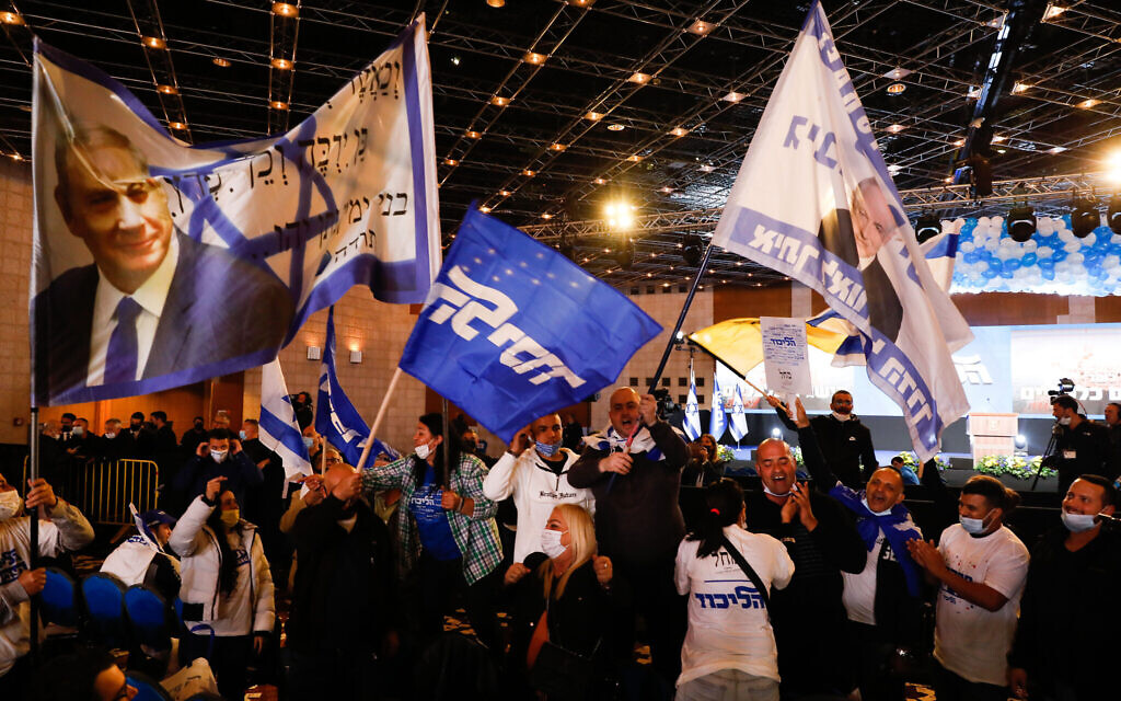 Likud supporters at Likud party headquarters in Jerusalem on elections night, March 23, 2021. (Olivier Fitoussi/Flash90)