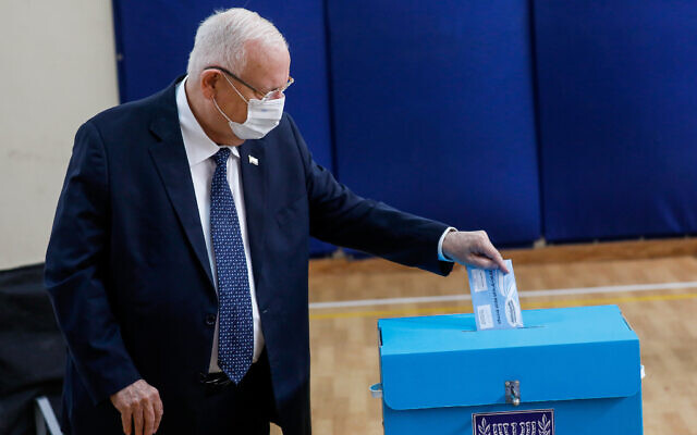 President Reuven Rivlin casts his ballot at a voting station in Jerusalem, during the Knesset Elections, on March 23, 2021. (Olivier Fitoussi/Flash90)