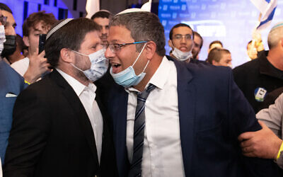 Head of the far-right Religious Zionism party MK Bezalel Smotrich and party member Itamar Ben Gvir with supporters at the party headquarters in Modi'in, on elections night, March 23, 2021. (Sraya Diamant/Flash90)