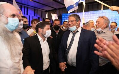 Religious Zionism party chairman Bezalel Smotrich (L) and candidate Itamar Ben Gvir celebrate at the party headquarters in Modi'in on election night, March 23, 2021. (Sraya Diamant/Flash90)