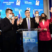 New Hope party leader Gideon Sa'ar and party members at the New Hope party headquarters in Tel Aviv, on elections night, on March 23, 2021. (Tomer Neuberg/Flash90)