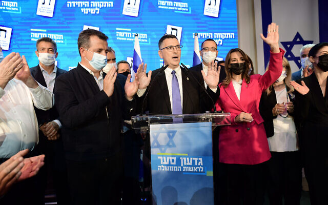 New Hope party leader Gideon Sa'ar and party members at the New Hope party headquarters in Tel Aviv, on election night, on March 23, 2021. (Tomer Neuberg/Flash90)