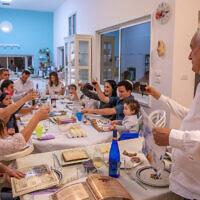 Illustrative photo of an Israeli family celebrating the Passover holiday in Moshav Yashresh on March 27, 2021. (Yossi Aloni/Flash90)