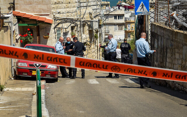 Security forces inspect the scene where a man was shot to death by a police officer after the man attempted to stab him, in Haifa, March 29, 2021. (Roni Ofer/Flash90)