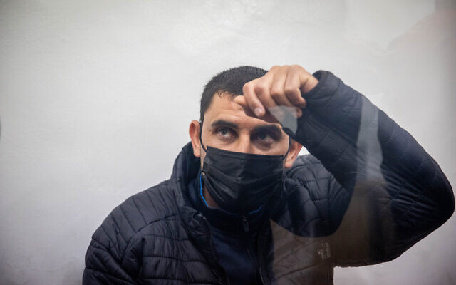 Ali Adkidak, suspected in the robbery and the assault of Israel Chef Shalom Kadosh arrives for a court hearing at the Jerusalem Magistrate's Court on March 28, 2021 (Yonatan Sindel/Flash90)