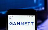 Gannett Media company logo seen displayed on a smart phone. (Igor Golovniov/SOPA Images/LightRocket/Getty Images via JTA)