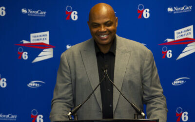Charles Barkley speaks at the podium prior to his sculpture being unveiled at the Philadelphia 76ers training facility in Camden, New Jersey, Sept. 13, 2019. (Mitchell Leff/Getty Images via JTA)