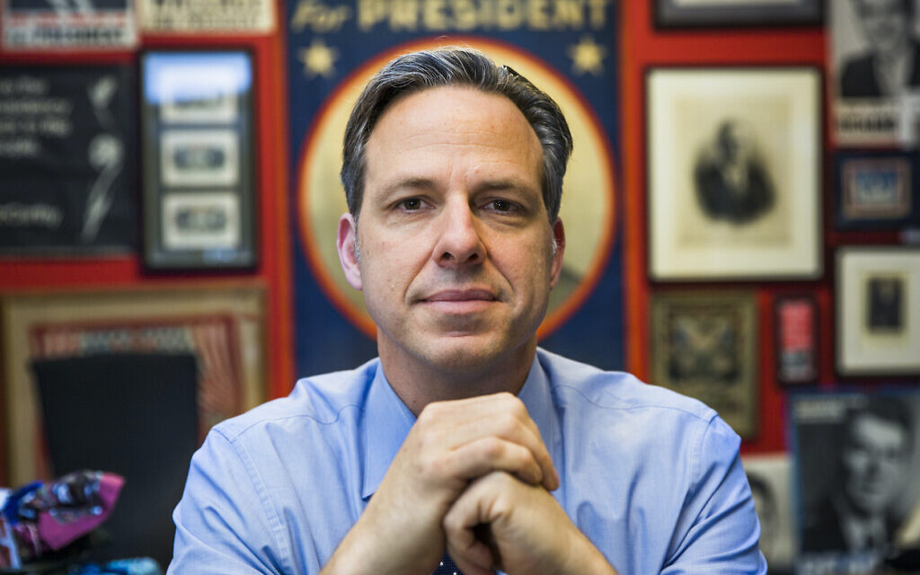 Jake Tapper in his Washington CNN office, which is decorated with posters from losing US presidential campaigns over the decades, in 2016. (Brooks Kraft/Getty Images via JTA)