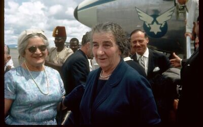 This color photograph from 1963 captures then Israeli foreign minister Golda Meir (later prime minister) arriving in Nairobi for an official diplomatic visit with an El Al plane in the background; as posted on Open Sea. (Courtesy)