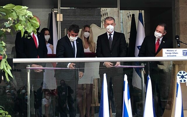 Foreign Minister Gabi Ashkenazi (second from left) and Czech Prime Minister Andres Babiš cut the ribbon at a ceremony opening the Jerusalem office of the Czech Embassy in Israel on March 11, 2021 (Lazar Berman/Times of Israel)
