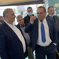 Likud MK Ayoub Kara, right, meets with Ra'am chief Mansour Abbas in the northern town of Maghar on March 27, 2021. (Screen capture: Twitter)