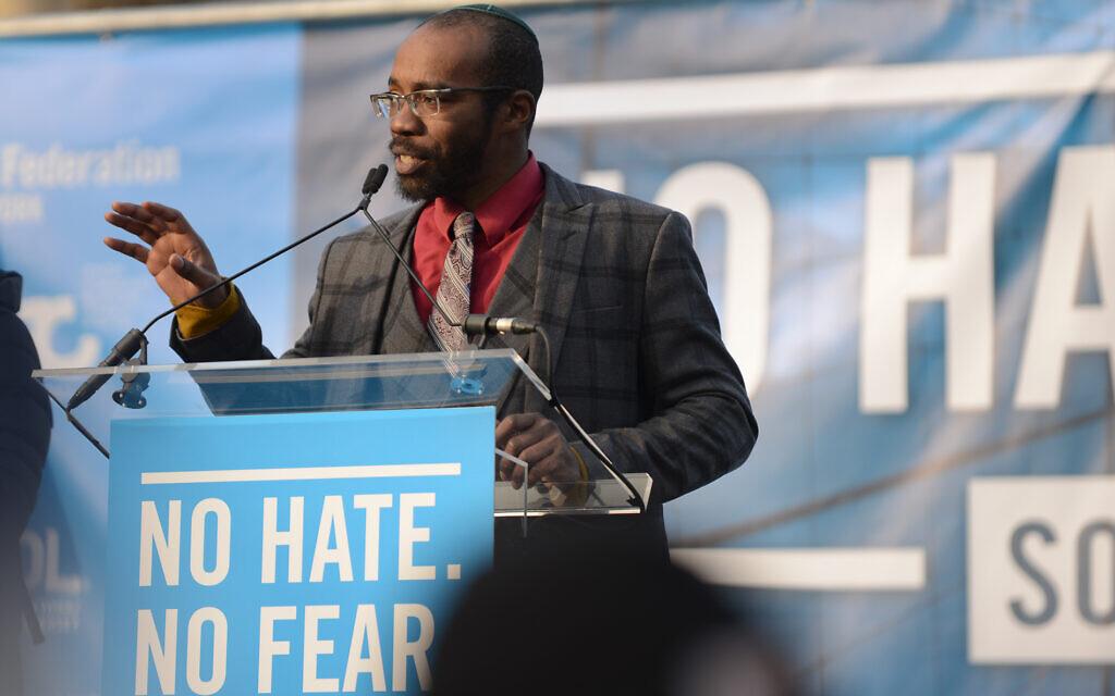 Rabbi Shais Rishon speaks at a rally in New York City, January 2020. (Gili Getz via JTA)