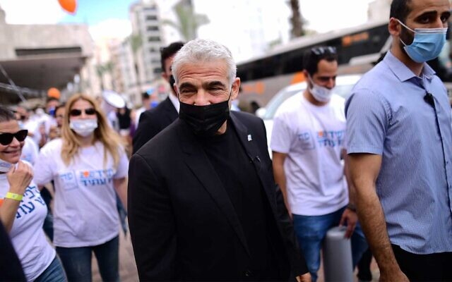 Yesh Atid party leader Yair Lapid during an election campaign tour in Hod Hasharon, March 19, 2021. (Tomer Neuberg/Flash90)