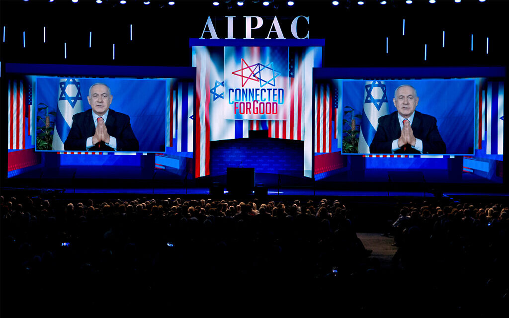 Prime Minister Benjamin Netanyahu speaks on a video from Israel to the 2019 American Israel Public Affairs Committee (AIPAC) policy conference, at Washington Convention Center, in Washington, March 26, 2019. (AP Photo/Jose Luis Magana)