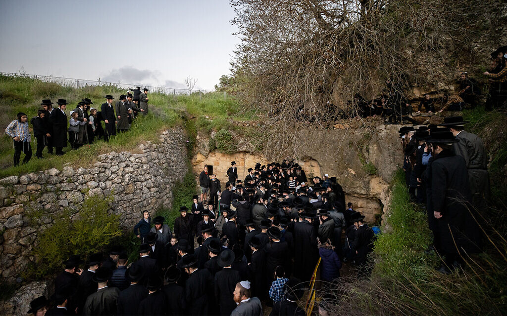 Ultra-Orthodox men collect water from a mountain spring outside Jerusalem on March 25, 2021. The water will be used in the making of matzah. (Yonatan Sindel/Flash90)