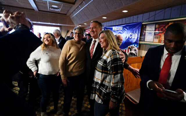Former US Secretary of State Mike Pompeo, center, poses for a photo with audience members after speaking at the West Side Conservative Club, March 26, 2021, in Urbandale, Iowa. (AP Photo/Charlie Neibergall)