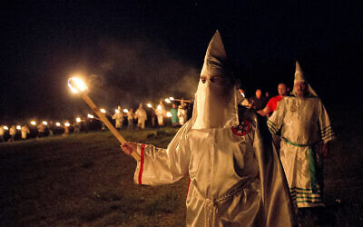 """llustrative: MIembers of the Ku Klux Klan participate in cross burnings after a """"White Pride,"""" rally, in rural Paulding County near Cedar Town, Georgia, April 23, 2016. (AP Photo/John Bazemore)"""