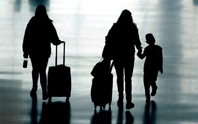 Travelers walk in Salt Lake City International Airport, in Salt Lake City, Utah, March 9, 2021. (AP Photo/Rick Bowmer)