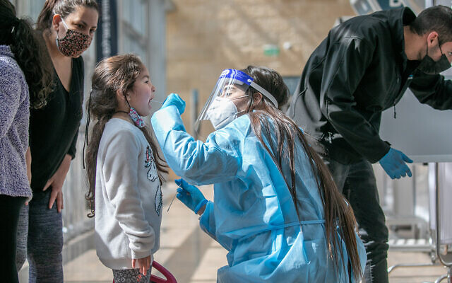 A technician collects nasal swab samples for COVID-19 testing at Ben-Gurion International Airport on February 28, 2021. (Yossi Aloni/Flash90)