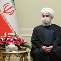 Iranian President Hassan Rouhani meets with Irish Foreign Minister Simon Coveney, in Tehran, Iran, March 7, 2021. (Iranian Presidency Office via AP)