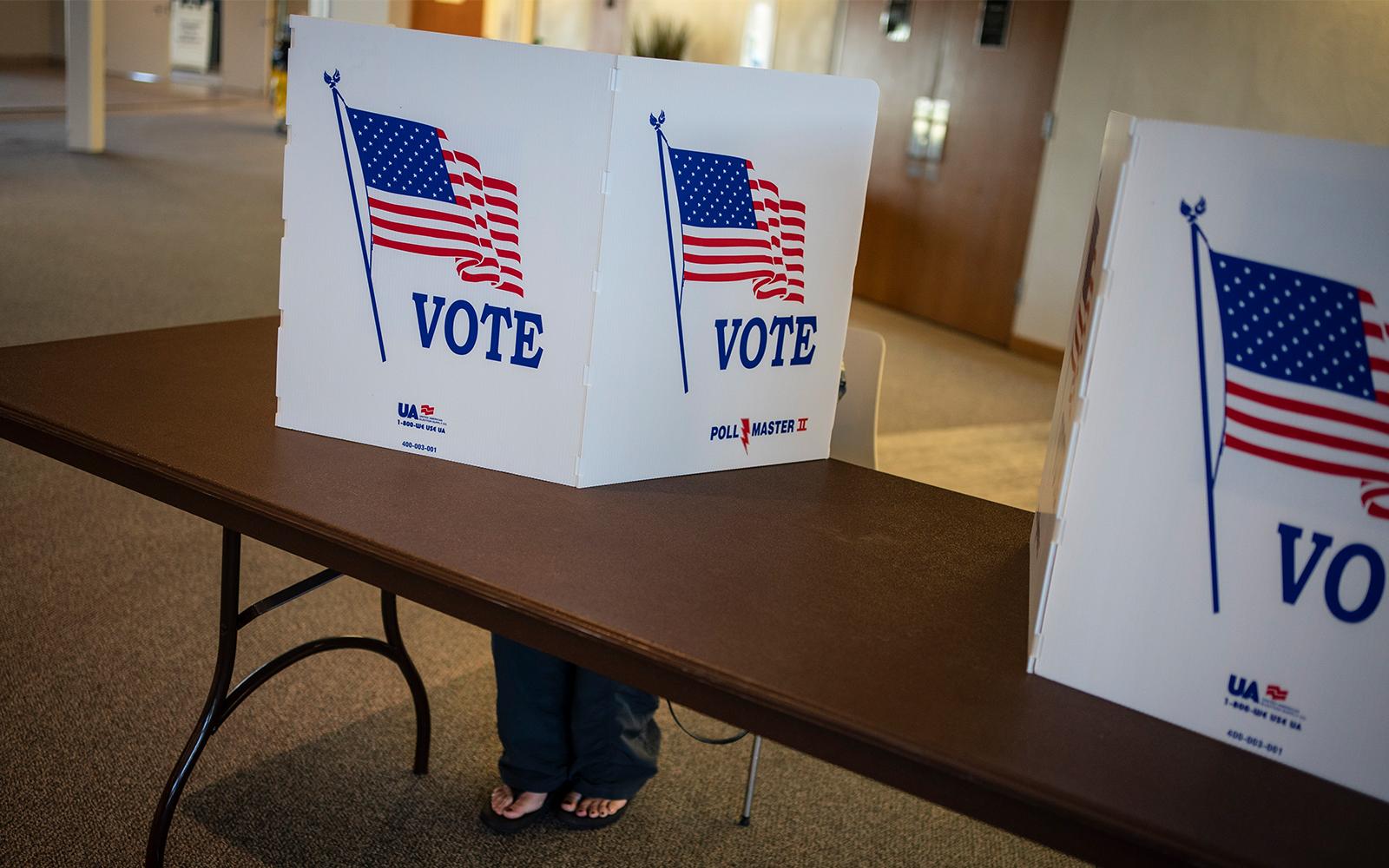 Illustrative A voter marks her ballot during the US presidential election in Kenosha Wisconsin Nov. 3 2020